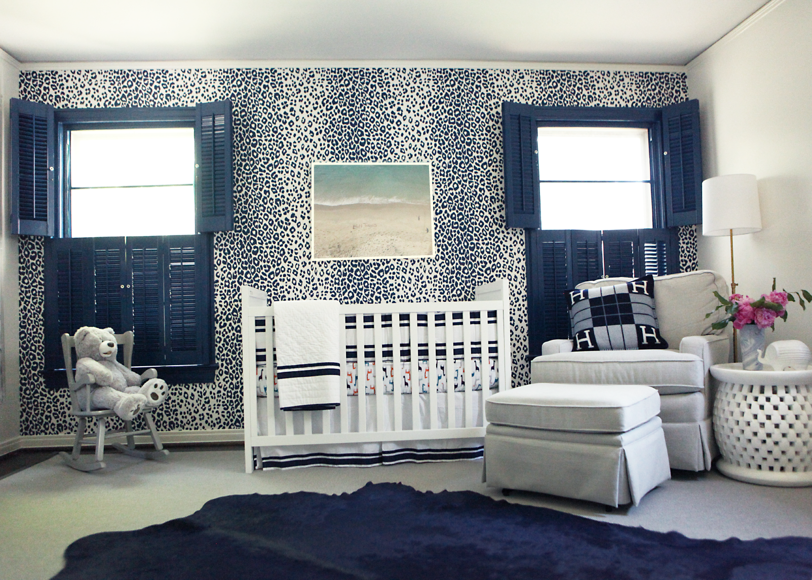 baby nursery with leopard accent wall